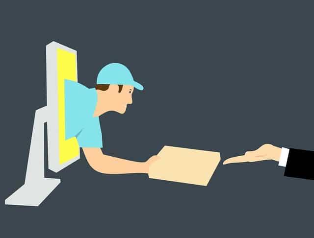 man komt uit de computer geeft paketje aan om dropshipping te beginnen